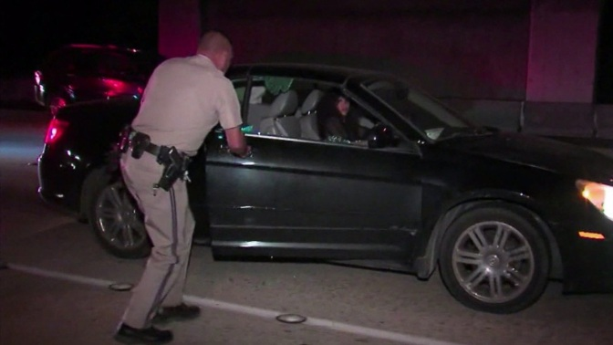 Hot woman passed out in her car in middle of a San Diego Freeway! (Video)